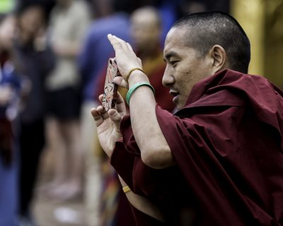 Buddhist monk with ancient two year old smart phone