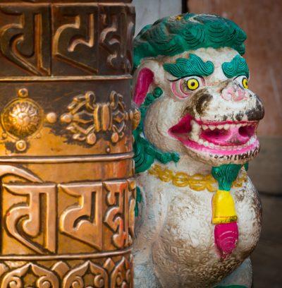 Prayer wheel by stupa